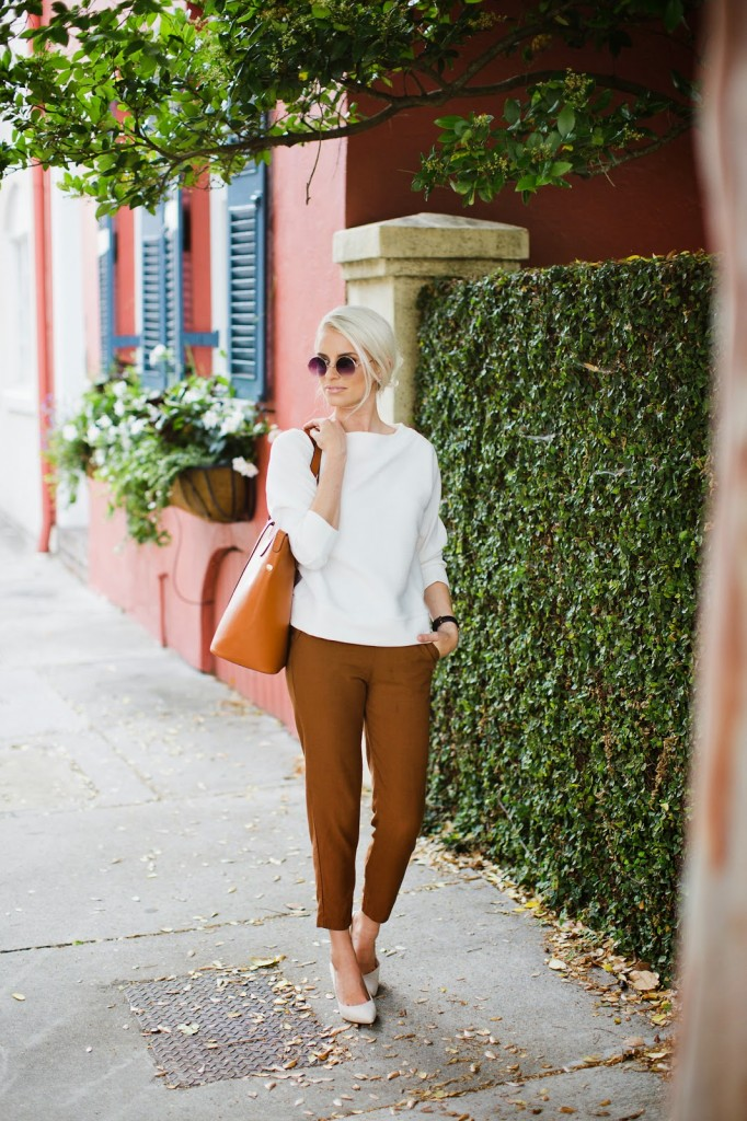 Charleston Fashion Blogger dannon k collard like the yogurt charleston street style downtown h&m wide textured white sweater tan camel trouser pants ms little bag bucket bag purse tote sante shoes greece beige pumps sidewalk vines attached homes window boxes planters flowers round frame sunglasses platinum blonde hair daniel wellington sheffield lady watch