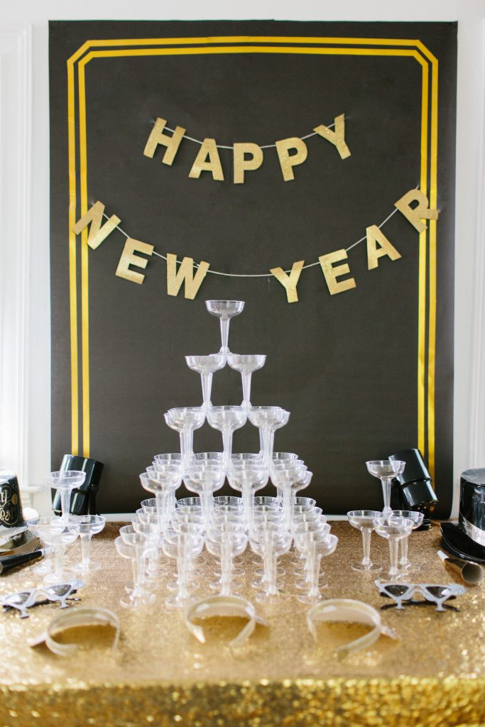 1920's New Years Party Charleston roaring twenties champagne tower great gatsby decor black white gold blush tablescape display black tie Charleston Fashion Blogger Dannon Like The Yogurt