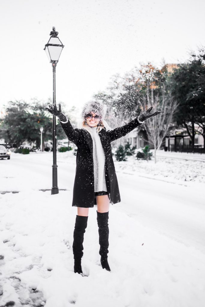 Snow Bunny in Charleston SC king street January 4th 2018 faux fur hat oversized sunglasses thigh high boots H&M forever 21 black coat high neck sweater Charleston Fashion Blogger Dannon Like The Yogurt